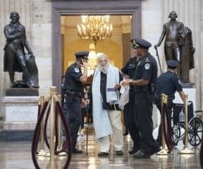 Photo of Rabbi Waskow being arrested in the US Capitol