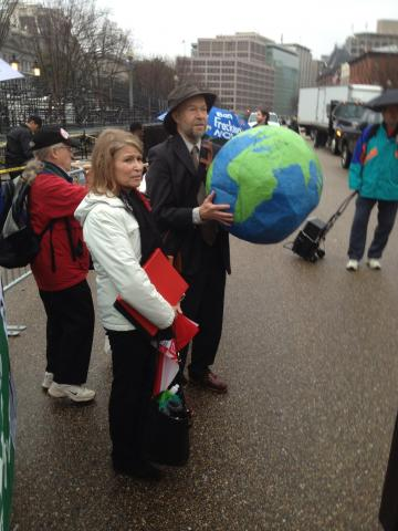 "Dr. James Hansen holding ""the whole world"" at the White House Pray-in"