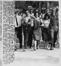 "Arrests of ""walk-inners"" seeking racial integration of Gwynn Oak amusement park in Baltimore, including Arthur Waskow (carrying shoes)"