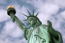 Lady Liberty in NY Harbor, focused on the Lamp she lifts