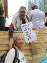 This photo by Jon Fein, echoing one of the prayers of Yom Kippur, shows Reb Arthur with Terry Kardos and her sign aboard Noah's Ark at the People's Climate March, 9/21/14]